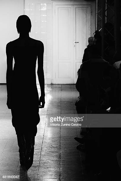 Model walks the runway at the Cedric Charlier show during Milan Men's Fashion Week Fall/Winter 2017/18 on January 16, 2017 in Milan, Italy.