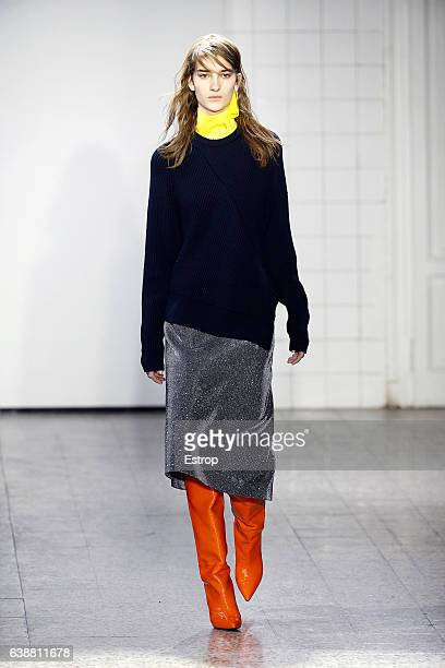 A model walks the runway at the Cedric Charlier show during Milan Men's Fashion Week Fall/Winter 2017/18 on January 16 2017 in Milan Italy