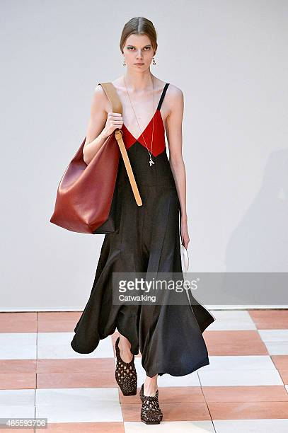 Model walks the runway at the Celine Autumn Winter 2015 fashion show during Paris Fashion Week on March 8, 2015 in Paris, France.