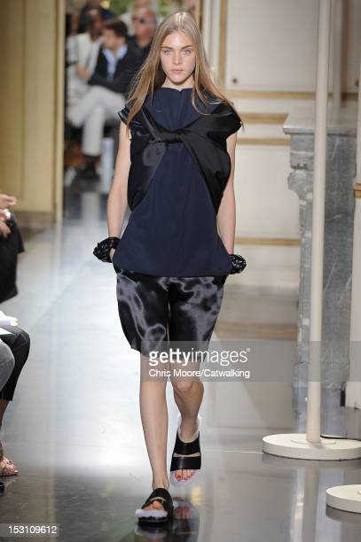 Model walks the runway at the Celine Spring Summer 2013 fashion show during Paris Fashion Week on September 30, 2012 in Paris, France.