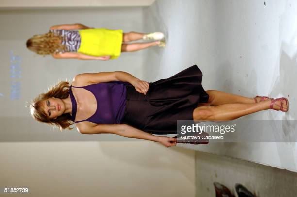 A model walks the runway at the Celine Spring/Summer 2005 Fashion Show at the Nikki Beach 7th Anniversary Party at Nikki Beach Club on December 12...
