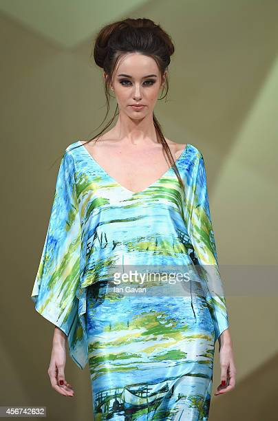 A model walks the runway at the Ceremony show during Fashion Forward at Madinat Jumeirah on October 6 2014 in Dubai United Arab Emirates