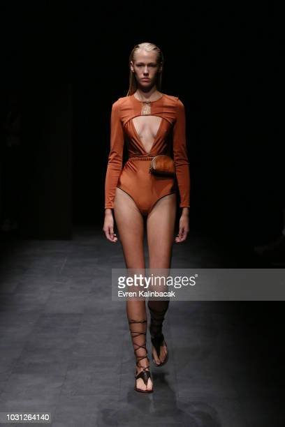 A model walks the runway at the Ceren Ocak show during the MercedesBenz Istanbul Fashion Week at Zorlu Performance Hall on September 11 2018 in...