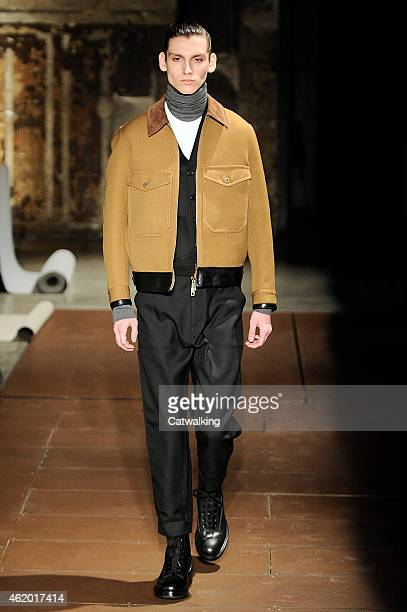 A model walks the runway at the Cerruti Autumn Winter 2015 fashion show during Paris Menswear Fashion Week on January 23 2015 in Paris France