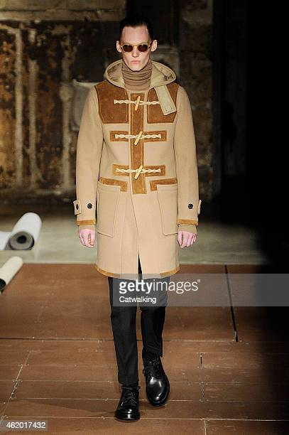 Model walks the runway at the Cerruti Autumn Winter 2015 fashion show during Paris Menswear Fashion Week on January 23, 2015 in Paris, France.