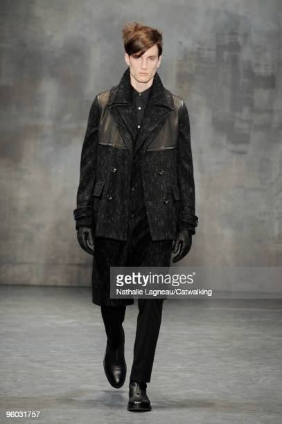 A model walks the runway at the Cerruti fashion show during Paris Menswear Fashion Week Autumn/Winter 2010 on January 22 2010 in Paris France