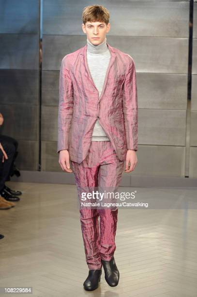 A model walks the runway at the Cerruti menswear fashion show during Paris Fashion Menswear Week on January 21 2011 in Paris France