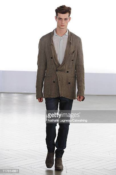 A model walks the runway at the Cerruti menswear fashion show during Paris Fashion Menswear Week on June 25 2011 in Paris France