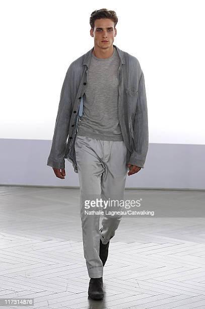 A model walks the runway at the Cerruti menswear fashion show during Paris Fashion Menswear Week on June 25 2011 in Paris France