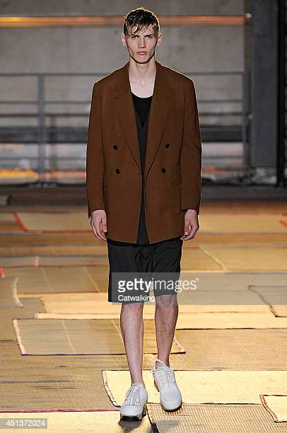 A model walks the runway at the Cerruti Spring Summer 2015 fashion show during Paris Menswear Fashion Week on June 27 2014 in Paris France