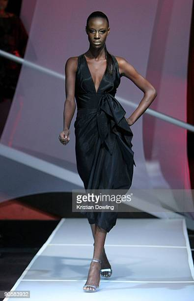 Model walks the runway at the Cesar Galindo Spring 2010 Fashion Show at the M2 Ultra Lounge during Mercedes-Benz Fashion Week at Bryant Park on...