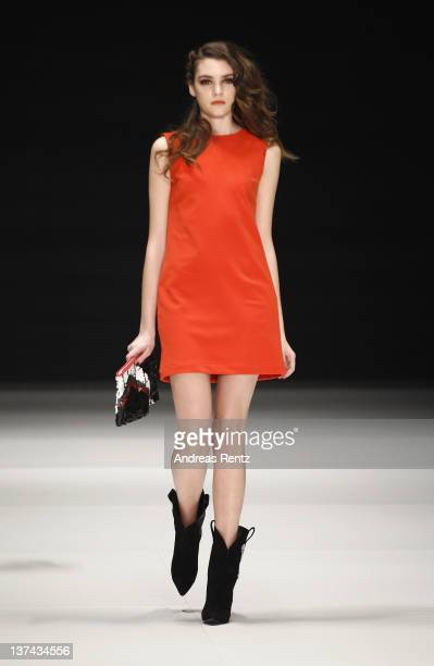 A model walks the runway at the C'est tout show during Michalsky StyleNite at MercedesBenz Fashion Week Berlin at Tempodrom on January 20 2012 in...