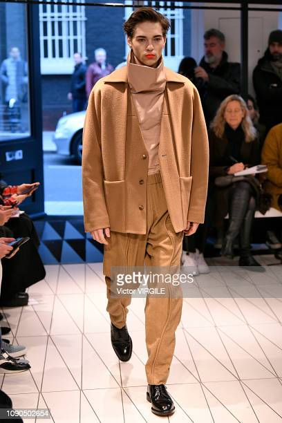 A model walks the runway at the Chalayan Fall/Winter 20192020 fashion show during London Fashion Week Men's January 2019 at the BFC Show Space on...