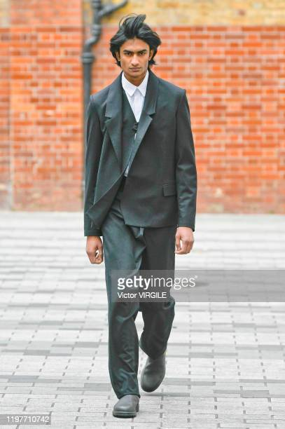 A model walks the runway at the Chalayan Fall/Winter 20202021 fashion show during London Fashion Week Men's January 2020 at the Chalayan Boutique on...
