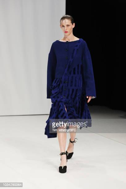 Model walks the runway at the CHALAYAN show during London Fashion Week September 2018 at Sadlers Wells Theatre on September 16, 2018 in London,...
