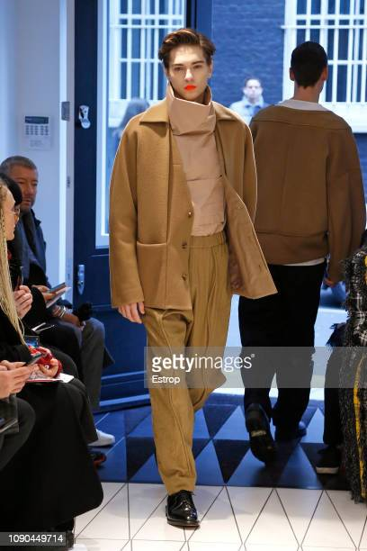 A model walks the runway at the Chalayan show during London Fashion Week Men's January 2019 at the Sadler's Wells Lillian Baylis Studio on January 6...