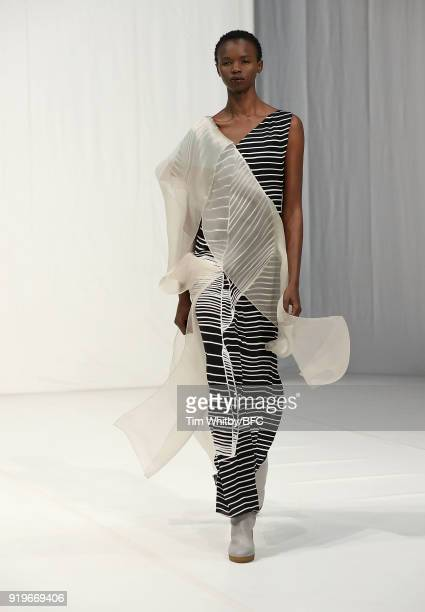 A model walks the runway at the Chalayan show during London Fashion Week February 2018 at Sadlers Wells Theatre on February 17 2018 in London England