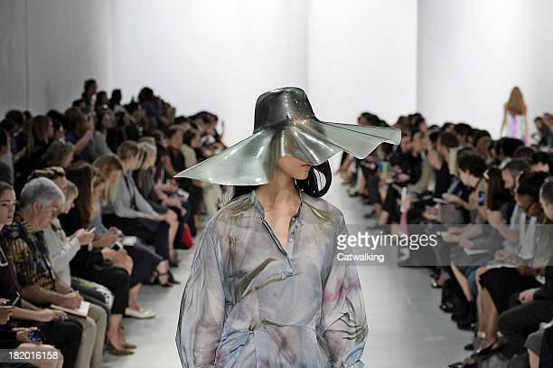 Model walks the runway at the Chalayan Spring Summer 2014 fashion show during Paris Fashion Week on September 27, 2013 in Paris, France.