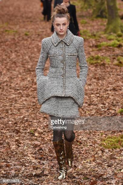A model walks the runway at the Chanel Autumn Winter 2018 fashion show during Paris Fashion Week on March 6 2018 in Paris France