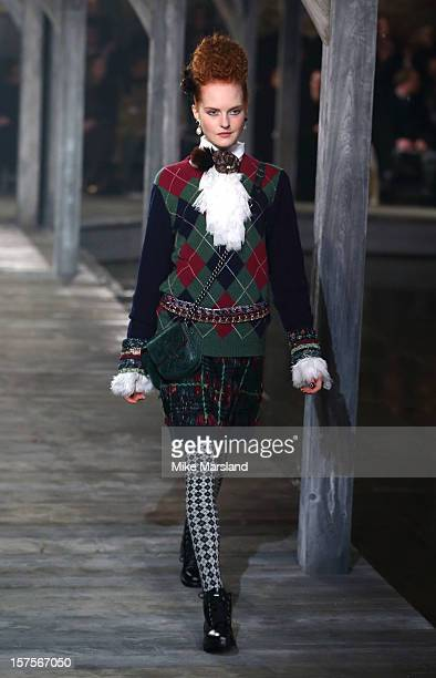 A model walks the runway at the CHANEL Metiers d'Art fashion show at Linlithgow Palace on December 4 2012 in Linlithgow Scotland