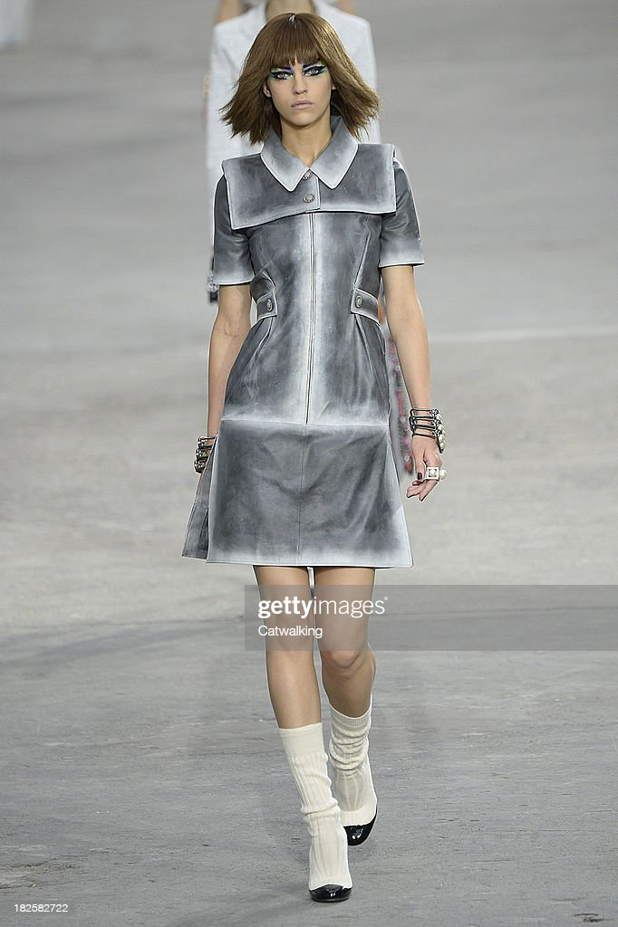 A model walks the runway at the Chanel Spring Summer 2014 fashion show during Paris Fashion Week on October 1, 2013 in Paris, France.
