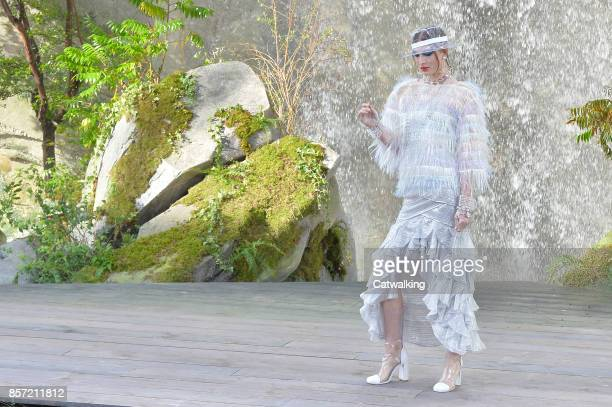 A model walks the runway at the Chanel Spring Summer 2018 fashion show during Paris Fashion Week on October 3 2017 in Paris France