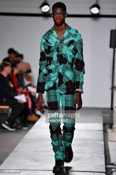 A model walks the runway at the Charles Jeffrey LOVERBOY Ready to Wear Spring/Summer 2020 fashion show during London Fashion Week Men's June 2019 on...