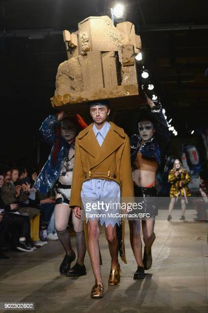 A model walks the runway at the Charles Jeffrey LOVERBOY show during London Fashion Week Men's January 2018 at Old Selfridges Hotel on January 7 2018...