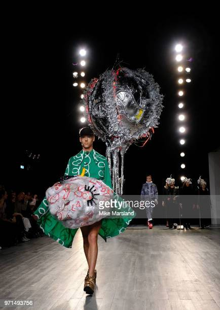 A model walks the runway at the Charles Jeffrey Loverboy show during London Fashion Week Men's June 2018 at the BFC Show Space on June 11 2018 in...