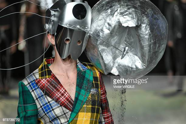 A model walks the runway at the Charles Jeffrey Loverboy Spring/Summer 2019 fashion show during London Fashion Week Men's June 2018 on June 11 2018...