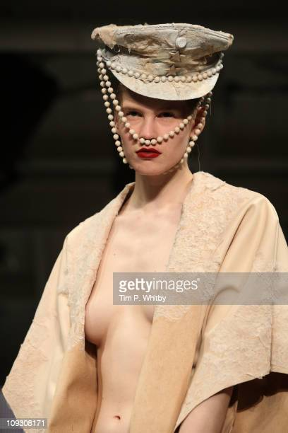 A model walks the runway at the Charlie Le Mindu show during London Fashion Week Autumn/Winter 2011 at Mercer Studios on February 20 2011 in London...