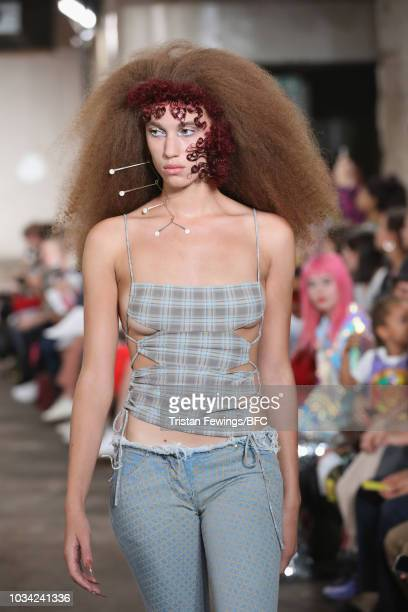 A model walks the runway at the Charlotte Knowles Fashion East show during London Fashion Week September 2018 on September 16 2018 in London England
