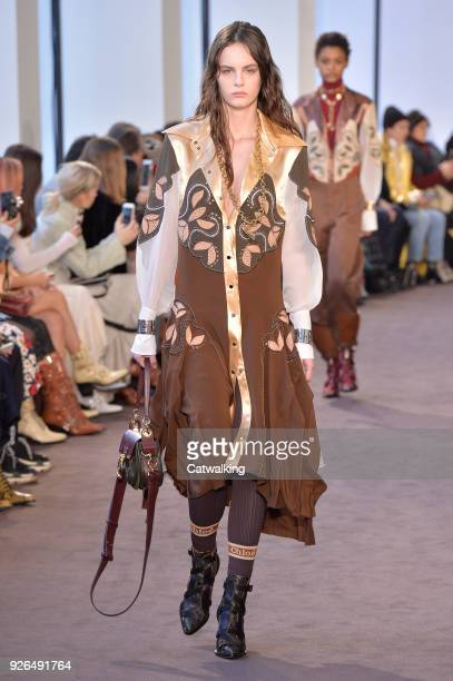 A model walks the runway at the Chloe Autumn Winter 2018 fashion show during Paris Fashion Week on March 1 2018 in Paris France