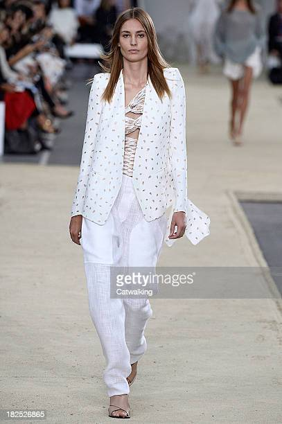 A model walks the runway at the Chloe Spring Summer 2014 fashion show during Paris Fashion Week on September 29 2013 in Paris France