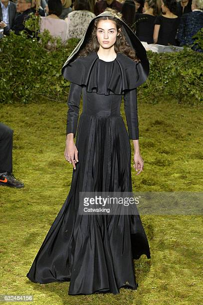 Model walks the runway at the Christian Dior Spring Summer 2017 fashion show during Paris Haute Couture Fashion Week on January 23, 2017 in Paris,...