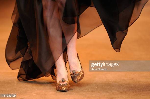 A model walks the runway at the Christian Siriano Fall 2013 fashion show with Payless ShoeSource during MercedesBenz Fashion Week at Eyebeam on...