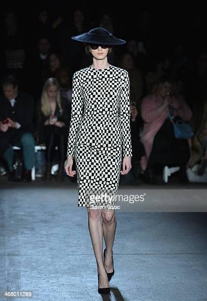 A model walks the runway at the Christian Siriano fashion show during MercedesBenz Fashion Week Fall 2014 at Eyebeam on February 8 2014 in New York...