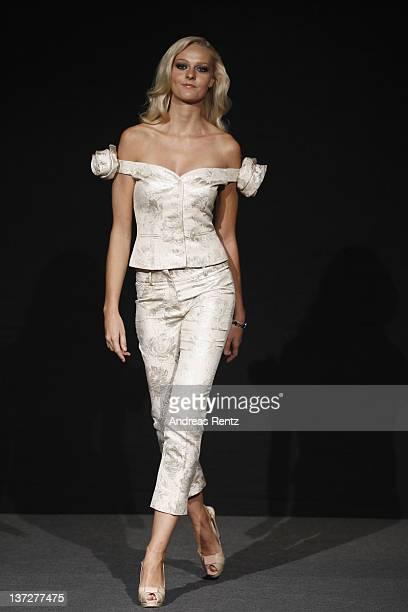 A model walks the runway at the Christina Duxa Autumn/Winter 2012 fashion show during MercedesBenz Fashion Week Berlin at Kempinski Ballsaal on...