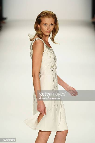 A model walks the runway at the Christina Duxa Couture Show during the Mercedes Benz Fashion Week Spring/Summer 2011 at Bebelplatz on July 7 2010 in...