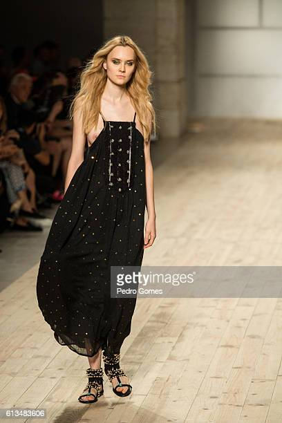 A model walks the runway at the Christophe Sauvat show during Lisboa Fashion Week Spring/Summer 2017 on October 8 2016 in Lisbon Portugal