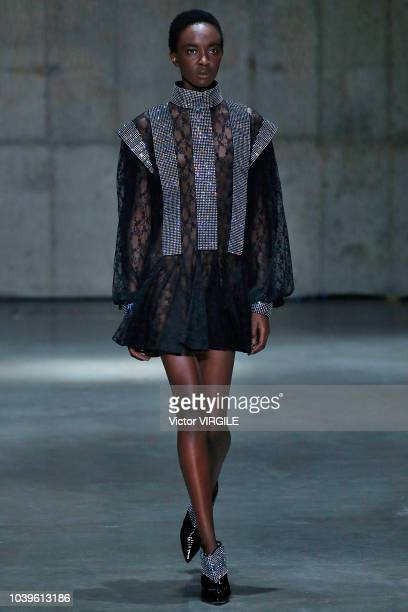 A model walks the runway at the Christopher Kane Ready to Wear Spring/Summer 2019 show during London Fashion Week September 2018 on September 17 2018...