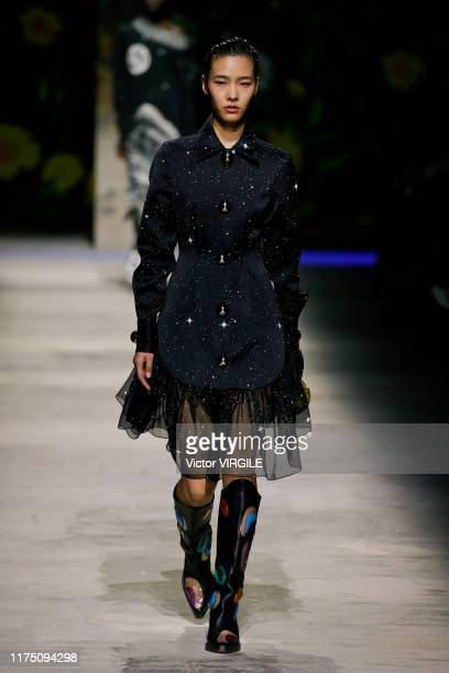 Model walks the runway at the Christopher Kane Ready to Wear Spring Summer 2020 fashion show during London Fashion Week September 2019 on September...