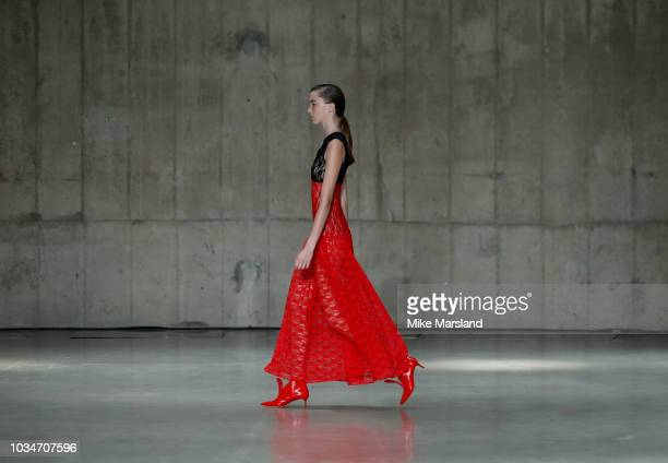 A model walks the runway at the Christopher Kane show during London Fashion Week September 2018 on September 17 2018 in London England