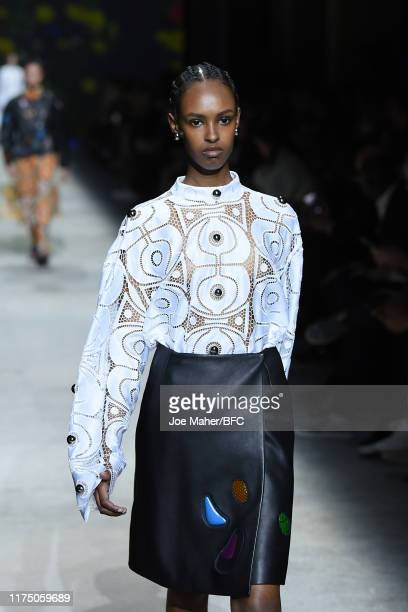 Model walks the runway at the Christopher Kane show during London Fashion Week September 2019 at Hawley Wharf on September 16, 2019 in London,...