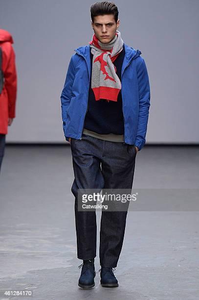 Model walks the runway at the Christopher Raeburn Autumn Winter 2015 fashion show during London Menswear Fashion Week on January 10, 2015 in London,...