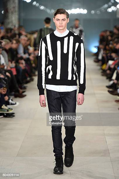 Model walks the runway at the Christopher Raeburn Autumn Winter 2016 fashion show during London Menswear Fashion Week on January 10, 2016 in London,...