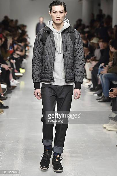 Model walks the runway at the Christopher Raeburn Autumn Winter 2017 fashion show during London Menswear Fashion Week on January 8, 2017 in London,...