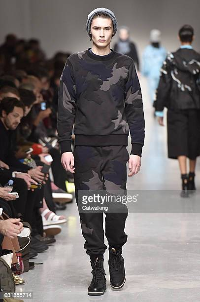 A model walks the runway at the Christopher Raeburn Autumn Winter 2017 fashion show during London Menswear Fashion Week on January 8 2017 in London...
