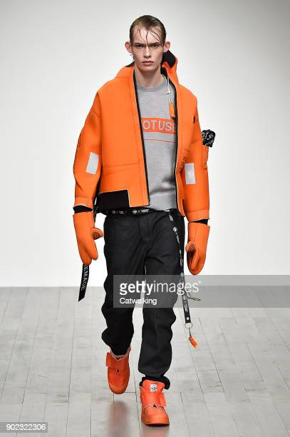 A model walks the runway at the Christopher Raeburn Autumn Winter 2018 fashion show during London Menswear Fashion Week on January 7 2018 in London...