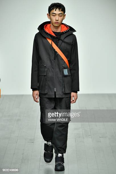 A model walks the runway at the Christopher Raeburn Fall/Winter 2018/2019 show during London Fashion Week Men's January 2018 at BFC Show Space on...